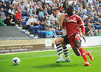 Middlesbrough's Albert Adomah vies for possession with Preston North End's Bailey Wright<br /> <br /> Photographer Kevin Barnes/CameraSport<br /> <br /> Football - The Football League Sky Bet Championship - Preston North End v Middlesbrough -  Sunday 9th August 2015 - Deepdale - Preston<br /> <br /> © CameraSport - 43 Linden Ave. Countesthorpe. Leicester. England. LE8 5PG - Tel: +44 (0) 116 277 4147 - admin@camerasport.com - www.camerasport.com