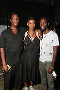 August 25, 2012-Brooklyn, NY: (L-R) Photographic Artist Baron Clairborne, Visual Artist Wangechi Mutu and Photographer Richard Rose backstage at the Afropunk Festival 2012 held in Brooklyn, NY on August 25, 2012. The Afropunk Festival has become a Brooklyn intuition, the focal point for the burgeoning Afro-punk movement. Over the past seven years, the festival has presented new artists before they hit it big, such as Grammy-nominated Santigold, The Noisettes and Janelle Monae. Afro-punk mainstays like Saul Williams, The Dirtbombs, and Dallas Austin have also graced Afro-punk's stages. (Terrence Jennings/TerrenceJennings.com)