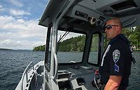 Dept of Safety Marine Patrol Sergeant Seth Alie heads out from Glendale on Lake Winnipesaukee Thursday afternoon.  (Karen Bobotas/for the Laconia Daily Sun)