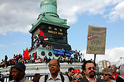 "Nous Voulons un vrai President: May Day March, Paris, 1 May 2009. Protest with sign that reads ""We want a true president"""