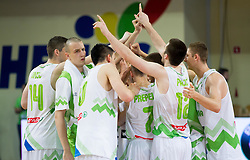 Players of Slovenia celebrate after winning the basketball match between National team of Slovenia and Italy in First Round of U20 Men European Championship Slovenia 2012, on July 12, 2012 in Domzale, Slovenia.  Slovenia defeated Italy 81-68. (Photo by Vid Ponikvar / Sportida.com)