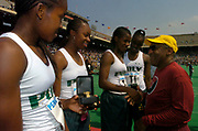 The Long Beach Poly High girls 4 x 100m relay (from left) Shalonda Solomon, Chanda Picott, Jasmine Lee and Shana Solomon are congratulated by Bill Cosby after setting a national high school record of 44.50 seconds in the 110th Penn Relays at  Franklin Field on Friday, April 23, 2004 in Philadelphia.