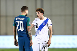 Petar Stojanovic of Slovenia talks to Kostas Tsimikas of Greece during football match between National teams of Greece and Slovenia in Final tournament of Group Stage of UEFA Nations League 2020, on November 18, 2020 in Georgios Kamaras Stadium, Athens, Greece. Photo by MATTHAIOS YORGOS / INTIME SPORTS / SPORTIDA