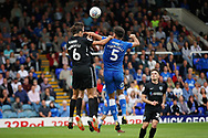 Peterborough United defender Ryan Tafazolli (5) and Portsmouth defender Christian Burgess (6) challenge for a header during the EFL Sky Bet League 1 match between Peterborough United and Portsmouth at London Road, Peterborough, England on 15 September 2018.