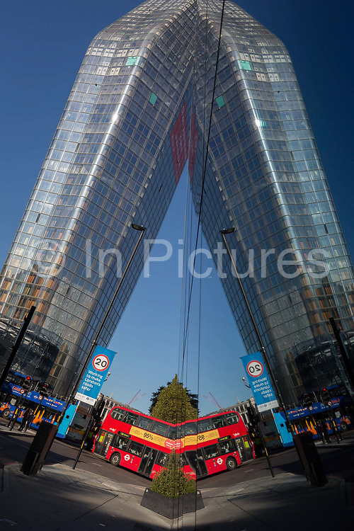 The symmetrical reflection of the One Blackfriars residential tower, on 27th October 2017, in Southwark, London, England. 1 Blackfriars or One Blackfriars, is a mixed-use development at the junction of Blackfriars Road and Stamford Street at Bankside, London. The development is a 52-storey 170m tower and two smaller buildings of 6 and 4 stories respectively. Uses include residential flats, a hotel and retail.