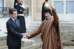 Libyan leader Moammar Gadhafi shakes hands with President Nicolas Sarkozy before their meeting at the Elysee Palace in Paris, France on December 10, 2007. Gadhafi is on a 5-Day State Visit to France for a high-profile visit set to usher in multi-billion-euro nuclear and aviation contracts. Photo by Abd Rabbo-Mousse/ABACAPRESS.COM