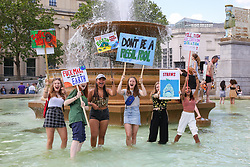 © Licensed to London News Pictures. 24/05/2019. London, UK. Students demonstrates in the Trafalgar Square's fountain during the Youth Strike 4 Climate Change Protest demanding the UK Government to declare a climate emergency. Photo credit: Dinendra Haria/LNP