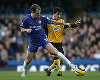 Photo: Lee Earle.<br /> Chelsea v Wigan Athletic. The Barclays Premiership.<br /> 10/12/2005. Chelsea's Arjen Robben (L) battles with Leighton Baines.