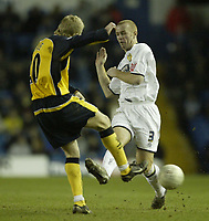 Photo: Aidan Ellis.<br /> Leeds United v Wigan Athletic. The FA Cup. 17/01/2006.<br /> Leeds Stephen Crainey tackles Wigan's Gary Teale