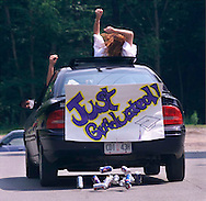 Delaware Valley graduates leave the school after their graduation on June 24 in Callicoon. (Tom Bushey photo. June 24, 2000).