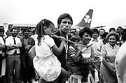 Gold medallist Eamonn Coughlan is surrounded by press and supporters on the tarmac of Dublin Airport on his return from the World Athletic Championships in Finland. His wife Yvonne and children Suzanne (four) and Eamonn Jr (two) are with him. His mother Kathleen looks on.<br /> 15 August 1983