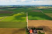 Nederland, Noordoostpolder, 30-06-2011; Tussen Espel en Emmeloord. De Noordoostpolder (NOP), is een voorbeeld van moderne grootschalige polder met rationele verkaveling. De aanleg van de polder maakte  deel uit van de Zuiderzeewerken (plan Lely) en viel in 1942 droog. De meeste boerderijen (en dorpen) zijn van na de tweede wereldoorlog..The northeast polder (NOP), is an example of modern large-scale polder with rational allotment. The construction of the polder was part of the Zuiderzee Works (Lely plan), in 1942 the polder was dry. Most of the building, farmhouses and villages, is post-war..luchtfoto (toeslag), aerial photo (additional fee required).copyright foto/photo Siebe Swart