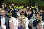 AFC Wimbledon fan holding scarf saying premier league during the EFL Carabao Cup 2nd round match between AFC Wimbledon and West Ham United at the Cherry Red Records Stadium, Kingston, England on 28 August 2018.