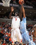 Jan. 8, 2011; Charlottesville, VA, USA;  Virginia Cavaliers center Assane Sene (5) is fouled by North Carolina Tar Heels forward John Henson (31) during the game at the John Paul Jones Arena. North Carolina won 62-56. Mandatory Credit: Andrew Shurtleff