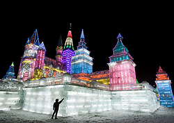 Spectacular illuminated ice sculptures at the Harbin Ice and Snow Festival in Heilongjiang Province China January 2009
