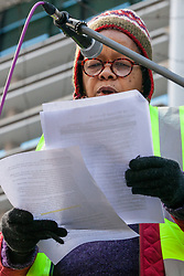 London, UK. 11th February, 2019. Sara Callaway of Women of Colour in the Global Women's Strike addresses campaigners against immigration deportations and the Government's hostile environment staging a 'People's Trial of the Home Office' including direct testimonies by individuals affected and performances by musicians and poets.