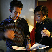 11/1/06  --- SPORTS SHOOTER ACADEMY --- Sports Shooter Academy co-founders Matt Brown and Robert Hanashiro, go over the shooting schedule during SSA III. Photo by Jordan Murph, Sports Shooter Academy Behind the Scenes with the cast and crew of Sports Shooter Academy.