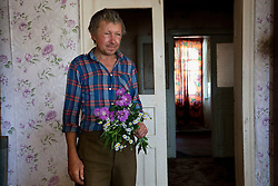 Vladimir Dovgal, boyfriend of Nadia Yarekha, watches as Vita Kalembet, a paralegal, talk in their home, Poltava, Ukraine, June 18, 2011. Yarekha, whose daughter was murdered in a domestic violence dispute came to Vita looking for guidance on how to legally adopt her granddaughter. More than half of the worldÕs population, four billion people live outside the rule of law, with no effective title to property, access to courts or redress for official abuse. The Open Society Justice Initiative is involved in building capacity and developing pilot programs through the use of community-based advocates and paralegals in Sierra Leone, Ukraine and Indonesia. The pilot programs, which combine education with grassroots tools to provide concrete solutions to instances of injustice, help give poor people some measure of control over their lives.