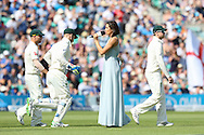 Soprano Laura Wright sings as players come onto the pitch before the third day of the 5th Investec Ashes Test match between England and Australia at The Oval, London, United Kingdom on 22 August 2015. Photo by Ellie Hoad.