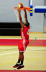Bristol Academy Flyers' Dwayne Lautier-Ogunleye dunks the ball into the basket - Photo mandatory by-line: Dougie Allward/JMP - Tel: Mobile: 07966 386802 23/03/2013 - SPORT - Basketball - WISE Basketball Arena - SGS College - Bristol -  Bristol Academy Flyers V Essex Leopards