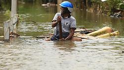 May 30, 2017 - Godagama, Sri Lanka - A Srilankan man rows a makeshift raft on a flooded road in Godagama, Matara, Sri Lanka. Tuesday 30 May 2017  (Credit Image: © Tharaka Basnayaka/NurPhoto via ZUMA Press)
