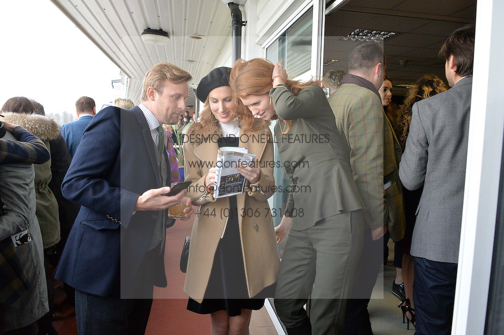 NEWBURY, ENGLAND 26TH NOVEMBER 2016: Left to right, Tom Hamilton, Susanna Warren and Lara Hughes Young at Hennessy Gold Cup meeting Newbury racecourse Newbury England. 26th November 2016. Photo by Dominic O'Neill
