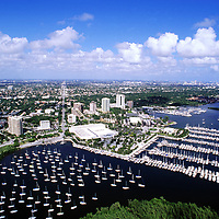 1997 Aerial view over Coconut Grove's Dinner Key Marina towards the Miami skyline.
