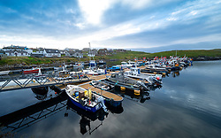 Early morning view of small fishing harbour at Hamnavoe, Shetland, Scotland, UK