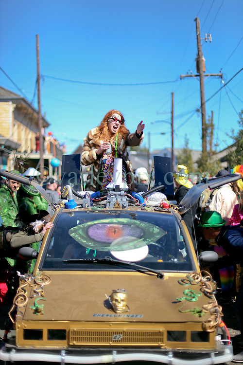 09 February 2016. New Orleans, Louisiana.<br /> Mardi Gras Day. Revelers in bright and colourful costumes fill the French Quarter. The car from Chewbacchus parade the previous weekend.<br /> Photo©; Charlie Varley/varleypix.com