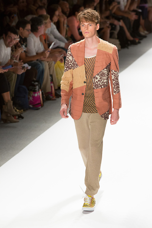 Men's open weave pants, striped T, and patchwork jacket. By Custo Barcelona at the Spring 2013 Fashion Week show in New York.
