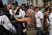 Members of the far-right supporters of jailed English Defence Force (EDF) leader Tommy Robinson make a counter-demonstration to those against the visit of US President Donald Trump to the UK, march through central London, on 13th July 2018, in London, England.