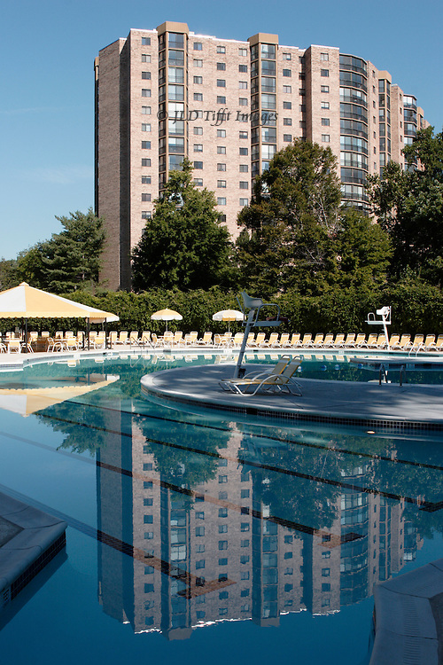 An aprtment building in the Montebello Condominium, Alexandria, Virginia, reflected in the swimming pool on the property.  Early morning soft light.