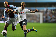 Tottenham's Lewis Holtby looks to go past Villa's Karim El Ahmadi. Capital one cup 3rd round match, Aston Villa v Tottenham Hotspur at Villa Park in Birmingham on Tuesday 24th Sept 2013. pic by Andrew Orchard, Andrew Orchard sports photography.