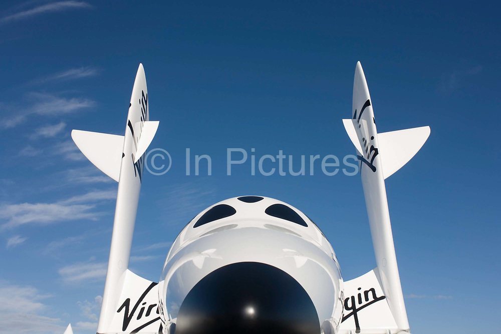 A scaled model of Virgin Galactic's space tourism vehicle, SpaceShipTwo (SS2) at the Farnborough air show. The Scaled Composites Model 339 SpaceShipTwo (SS2) is a suborbital, air-launched spaceplane, designed for space tourism. It is under development by The Spaceship Company, a California-based joint venture between Scaled Composites and the Virgin Group, as part of the Tier 1b program. The Virgin Galactic spaceline plans to operate a fleet of five SpaceShipTwo spaceplanes in a private passenger-carrying service, starting in late 2013 and are already taking bookings, with a suborbital flight carrying a ticket price of US$200,000. The duration of the flights will be approximately 2.5 hours, though only a few minutes of that will be in space.