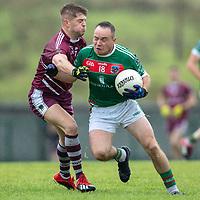 Kilmurry Ibrickane's Steven Moloney is tackled by Lissycasey's Oisin Hanrahan