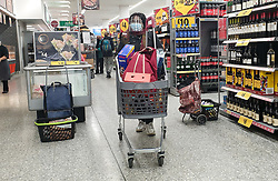 © Licensed to London News Pictures. 24/12/2020. London, UK. A shopper wearing a visor in Morrison supermarket in north London doing her last minute shopping on Christmas Eve. The government has announced that a new COVID-19 mutation has been discovered in the UK in people who travelled from South Africa. As coronavirus continues to spread more areas will go into Tier 4 from Boxing Day. Photo credit: Dinendra Haria/LNP