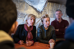 © London News Pictures. Calais, France. 04/03/16. Actress Juliet Stevenson (left), Producer Tracey Seaward (centre) and Director Stephen Daldrey meet with four unaccompanied Syrian boys who live in the Calais 'Jungle' camp and have family in Britain. They are the first celebrities to join the Citizens UK and Help Refugees 'buddy scheme' which aims to put pressure on the British government to allow unaccompanied minors in the Calais 'Jungle' to be reunited with their families in the United Kingdom.Photo credit: Rob Pinney/LNP