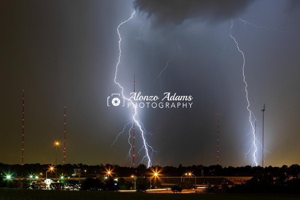 Lightning strikes around radio and tv communication towers in Oklahoma City on June 8, 2013. Photo copyright © 2013 Alonzo J. Adams.