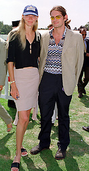 Model MISS JODIE KIDD and her close friend MR JOEL CHINN, at a polo match in Berkshire on 25th July 1999.MUM 187