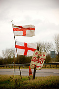 Ron's Snacks sign and St Georges cross flags at a roadside burger van in a layby along the northbound A1 on 26th February 2010 in Alconbury in the United Kingdom.