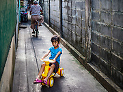 16 MAY 2018 - BANGKOK, THAILAND: A child plays in an alley in front of Masjid (Mosque) Darul Falah,  a small mosque in Baankrua, the oldest Muslim neighborhood in Bangkok on the first night of Ramadan. Based on the sighting of the new moon, Ramadan fasting starts on Thursday, 17 May in Thailand.      PHOTO BY JACK KURTZ