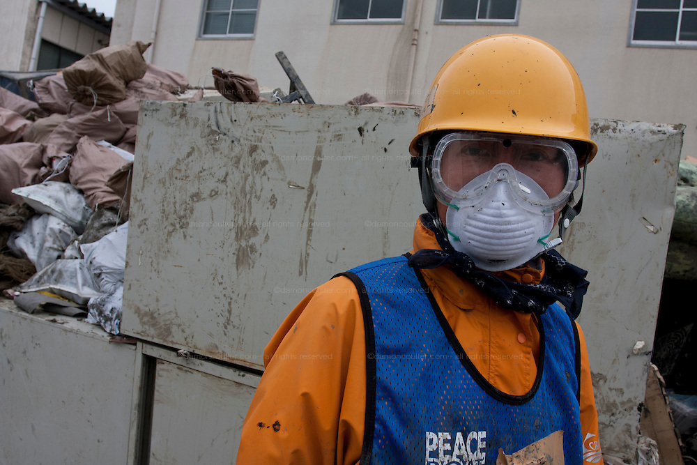 Portrait of a Peace boat volunteer taking part in the clean-up operations in Ishinomaki, Miyagi Friday May 6th 2011. Around 350 volunteers took part in the relief effort over the Golden Week holiday, including 41 foreigners, clearing mud and removing debris from this coastal town which more almost levelled in the March 11th earthquake and tsunami.