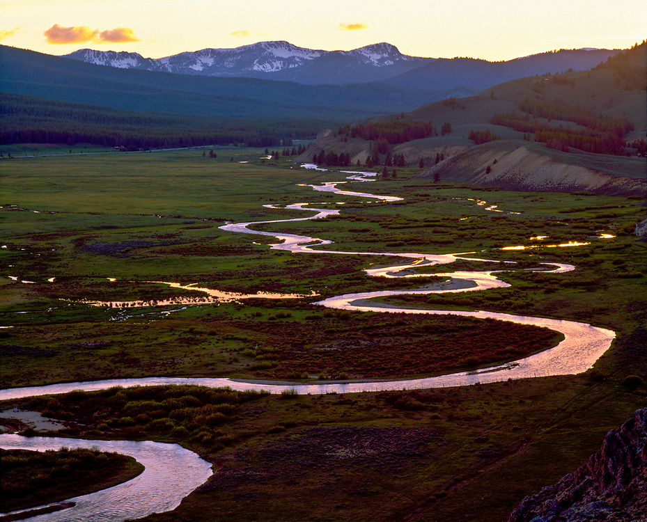 Stanley Creek meanders toward the Salmon River near Stanley Idaho with the snow capped Sawtooth Mountains in the background at sunset. Licensing and Open Edition Prints