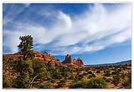 Paint brush clouds against an azure blue sky in a local park at beautiful Sedona Arizona, USA