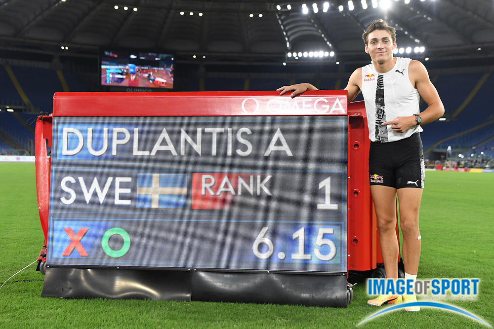 Mondo Duplantis (SWE) poses with the scoreboard after winning the pole vault in an outdoor world record 20-2 (6.15m) during the Mennea Golden Gala at Stadio Olimpico, Thursday, Sept. 17, 2020, in Rome. (Jiro Mochizuki/Image of Sport)