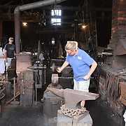 An ironmonger demonstration on the historic waterfront at Mystic seaport. Mystic, Connecticut. 21st July 2013. Photo Tim Clayton