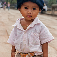 Little boy posing near the entrance of Angkor Wat.