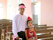 Portrait of a Kayah ethnic minority couple on their wedding day on 22nd March in Kayah State, Myanmar. In the past most people residing in Kayah State were traditional spirit worshippers, but significant numbers have converted to Christianity, especially  Baptists or Catholics