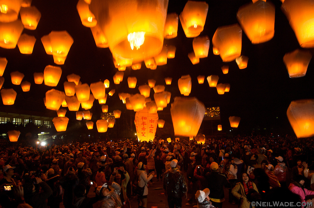 """In Pingsi, Taiwan, thousands of people release """"Sky Lanterns"""" on the 15th day of the new lunar year.  With the launcher's hopes and dreams written on the lantern, it is said that the higher the lantern goes, the closer it will come to God, and the better the chances that the wish will come true."""