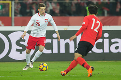 March 27, 2018 - Chorzow, Poland - Tomasz Kedziora of Poland vies Joo-ho Park (KOR),  during the international friendly soccer match between Poland and South Korea national football teams, at the Silesian Stadium in Chorzow, Poland on 27 March 2018. (Credit Image: © Foto Olimpik/NurPhoto via ZUMA Press)